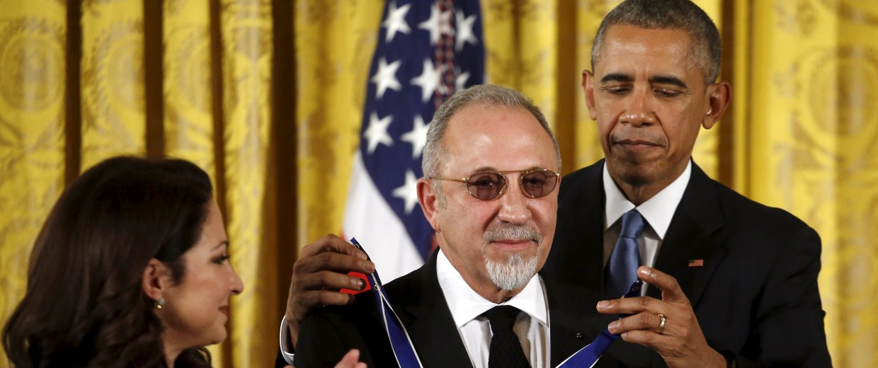 Image: U.S. President Barack Obama presents the Presidential Medal of Freedom to producer Emilio Estefan as he stands next to his wife Gloria Estafan during an event in the East Room of the White House in Washington