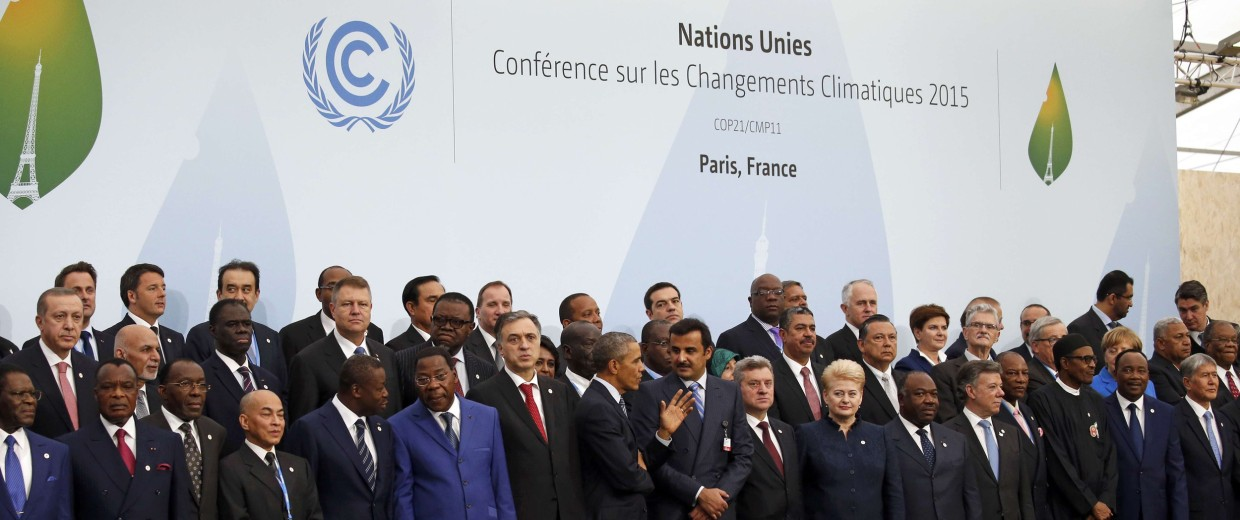 Image: US President Obama talks with fellow world leaders during a family photo for the opening day of the World Climate Change Conference 2015 (COP21) at Le Bourget