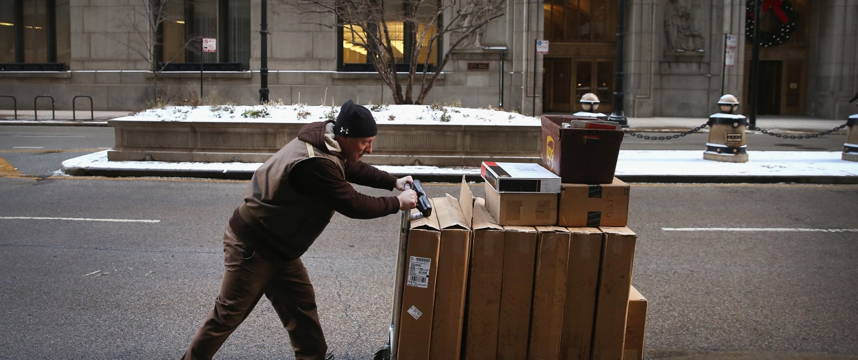 Image: A UPS worker delivers packages in Chicago