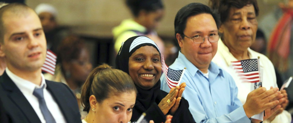 Image: Isatu Barrie smiles after taking part in the United States Oath of Citizenship during a naturalization ceremony in the Brooklyn borough of New York