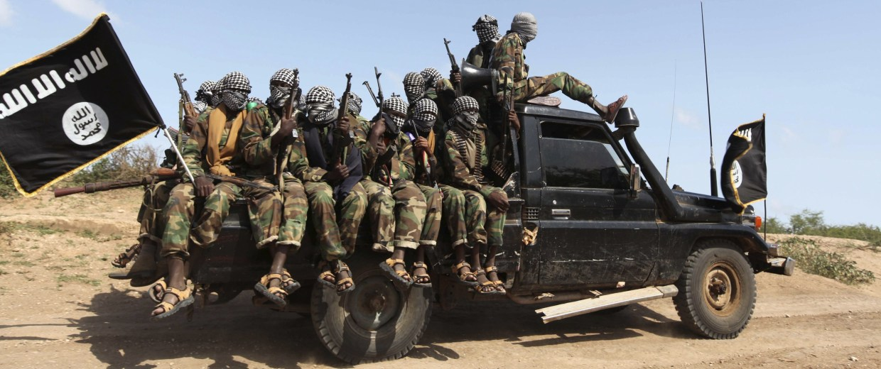 Image: Members of al Shabaab ride in a pick-up truck outside Somalia's capital Mogadishu