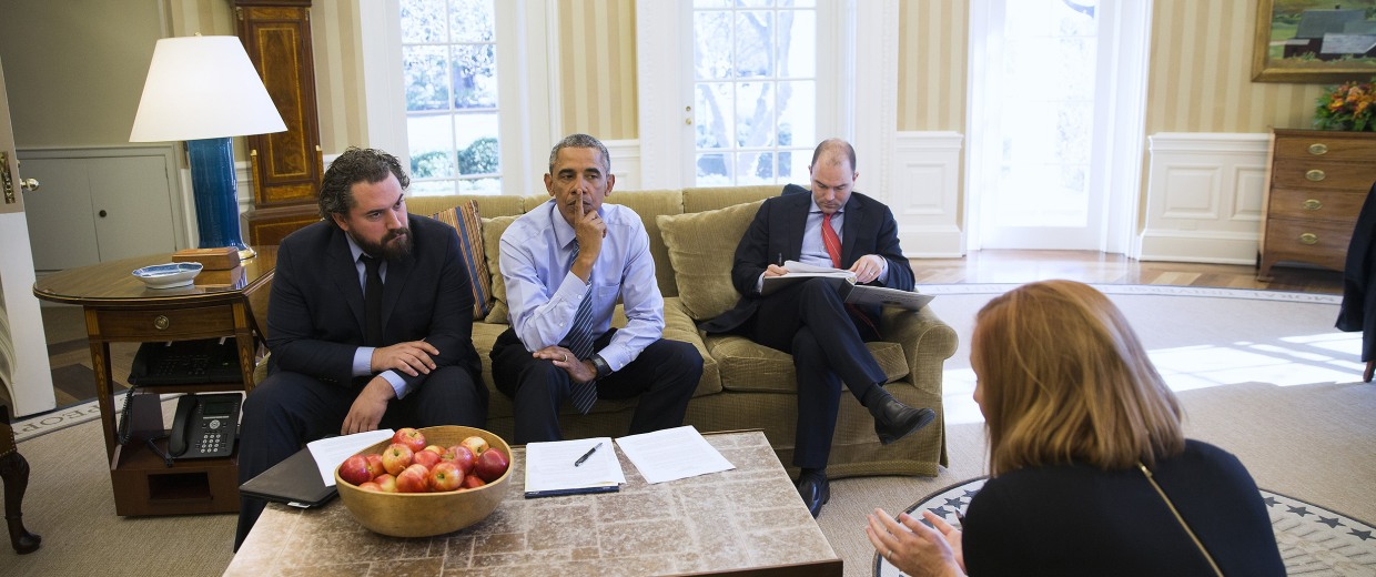 Image: President Barack Obama works with Cody Keenan, left, the president's director of speechwriting, Ben Rhodes, the deputy national security adviser, and Jen Psaki, foreground, Director of  White House Communications, in the Oval Office of the White