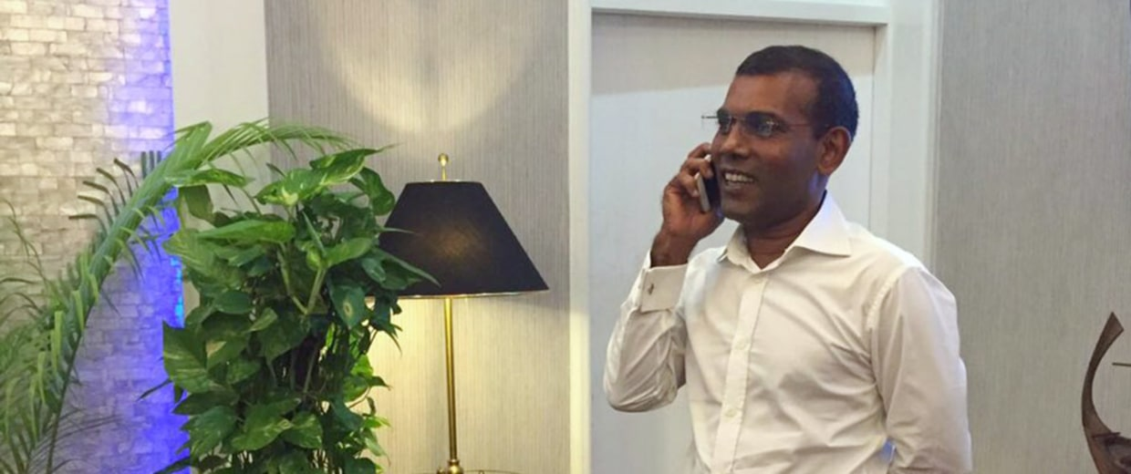 Image: Former Maldives president Mohamed Nasheed speaks on the phone with U.S. Secretary of State John Kerry