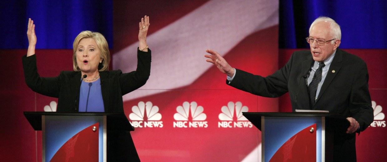 Image: Democratic U.S. presidential candidate and former Secretary of State Hillary Clinton and rival candidate U.S. Senator Bernie Sanders speak simultaneously at the Democratic presidential candidates debate in Charleston