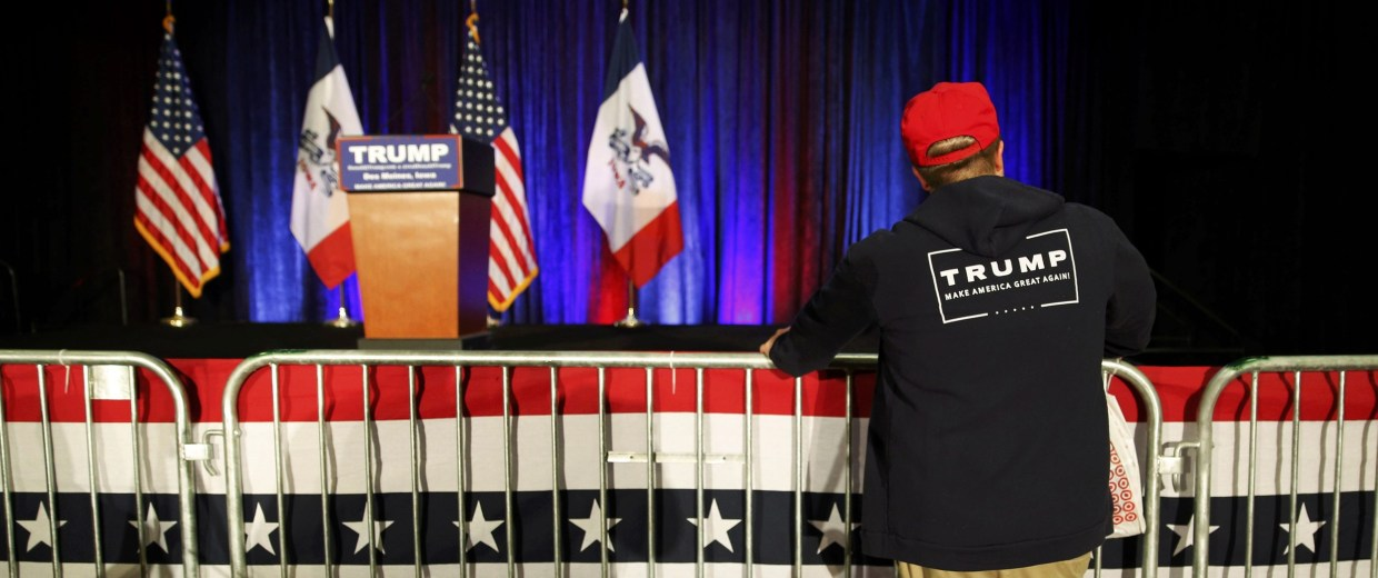 Image: Austin Bayliss of Altoona, Iowa, watches as the stage for U.S. Republican presidential candidate Trump's caucus night rally is taken down in West Des Moines, Iowa