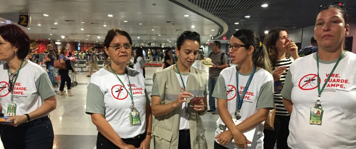 Image: Workers greet passengers at Recife airport with Zika information on Feb. 4