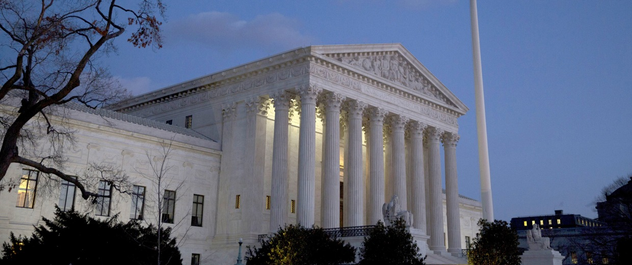 Image: The American flag flies in front of the U.S. Supreme Court