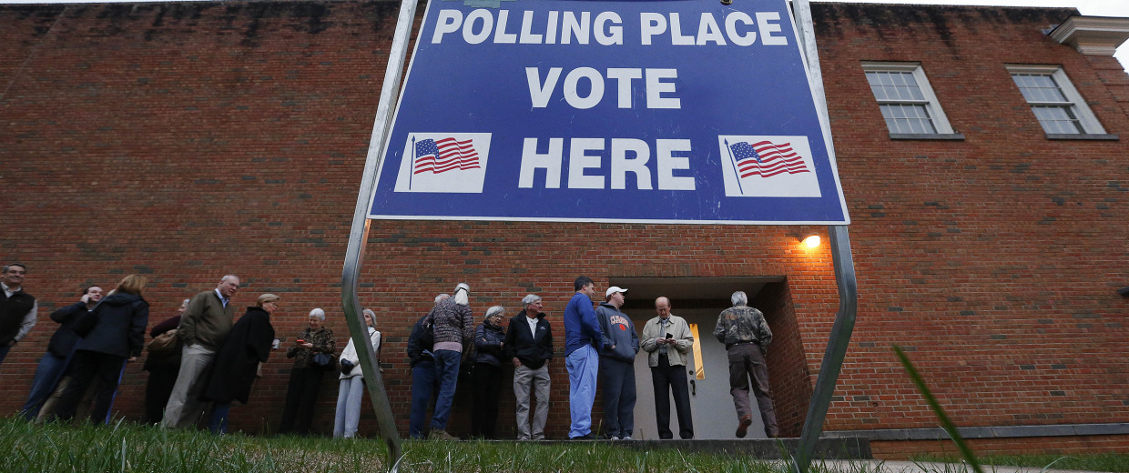 Image: Voters wait in line for a polling place to open at Eastlan Baptist Church
