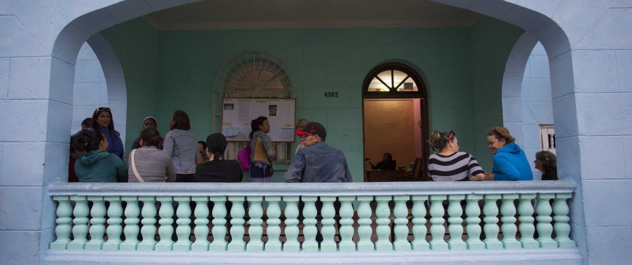Parents mingle as they wait for their children to be let out of an English lesson at the Cuban School of Foreign Languages