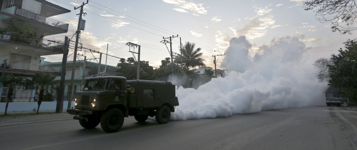 Image: A military truck carries out fumigation in a neighborhood to stop the breeding of the dengue mosquito in Havana