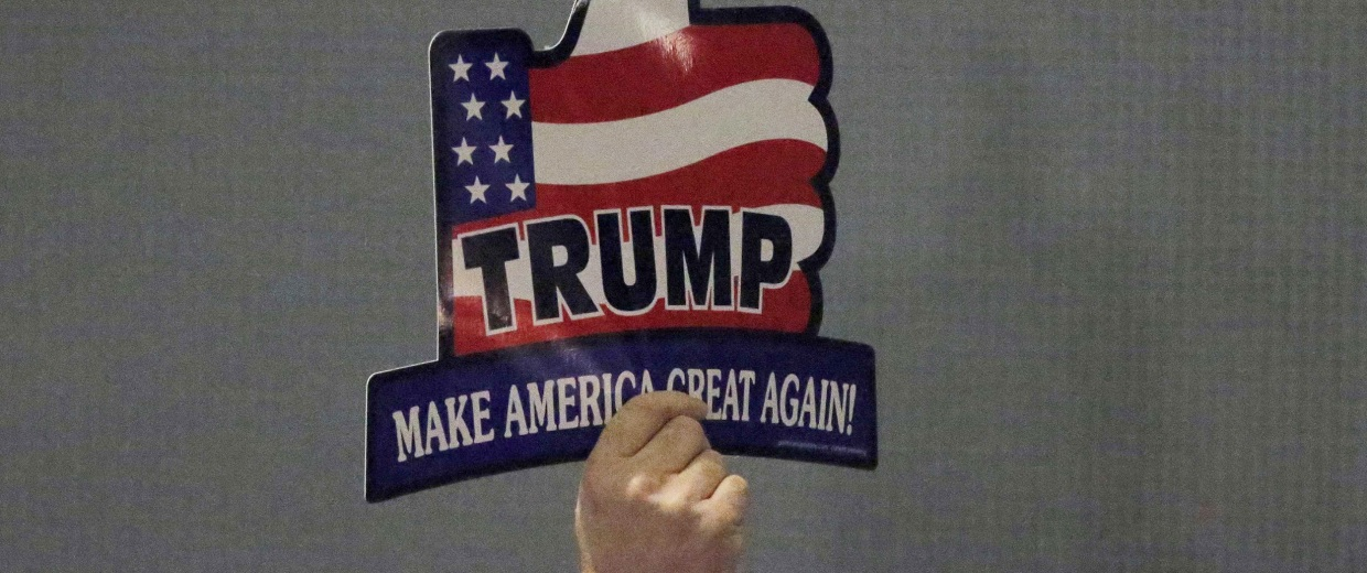 Image: A supporter for U.S. Republican presidential candidate Trump holds sign during campaign event in Hickory, North Carolina
