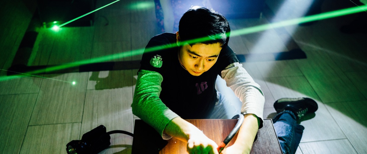 Image: Tony Wang looks for clues with a group of his friends at OMESCAPE on West 38th Street in NYC while they try to escape from the game on Friday, March 25, 2016.