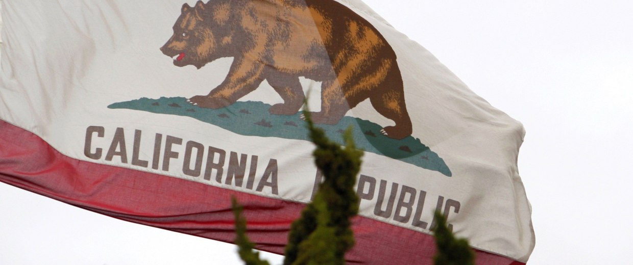 Image: File photo of the California state flag flying above City Hall in Santa Monica