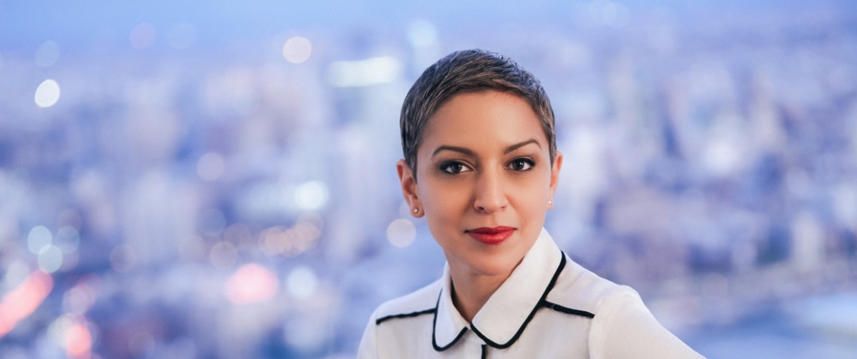 "Headshot of Carmen Rita, author of ""Never Too Real."""