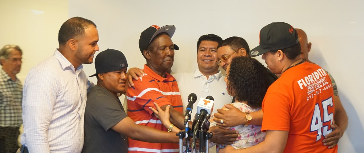 Plaintiffs embrace labor leader, Modesta Toribio (center) after she commends and congratulates them for their work.