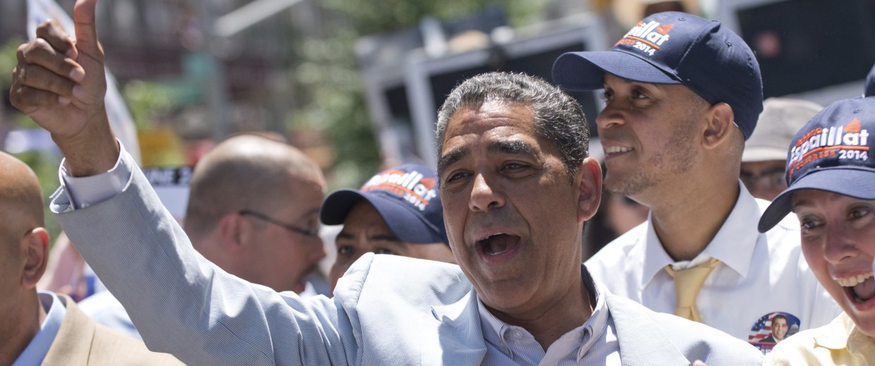 Image: Senator Adriano Espaillat sings while giving a thumbs up to supporters during a caravan to get out the vote in New York
