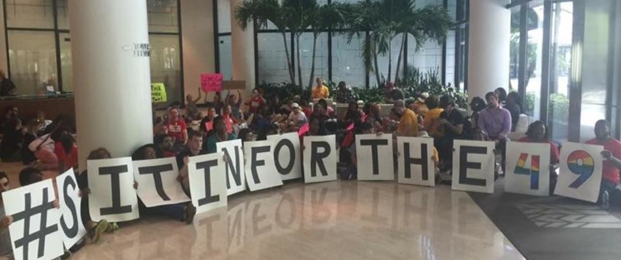 Over 60 activists stage a sit-in inside of Sen. Marco Rubio, R-Fla., and his policies regarding LGBT people and guns.