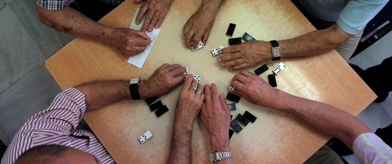 "Image: Pensioners play dominoes at ""Anica Torres"" seniors centre in Benalmadena"