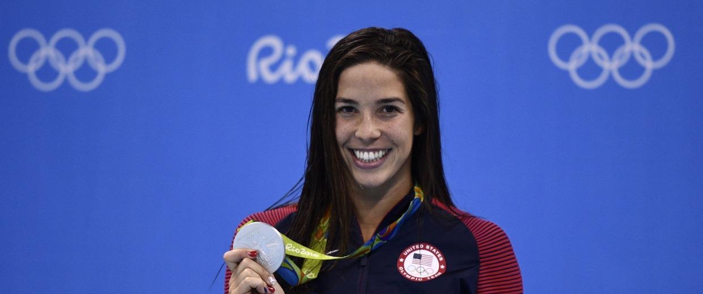 "USA's Madeline ""Maya"" Dirado poses with her silver meda"