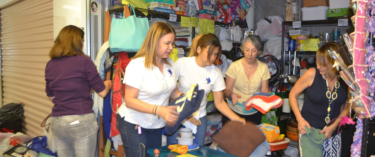Patricia Andrade (left) and other volunteers organizing one of the storage spaces