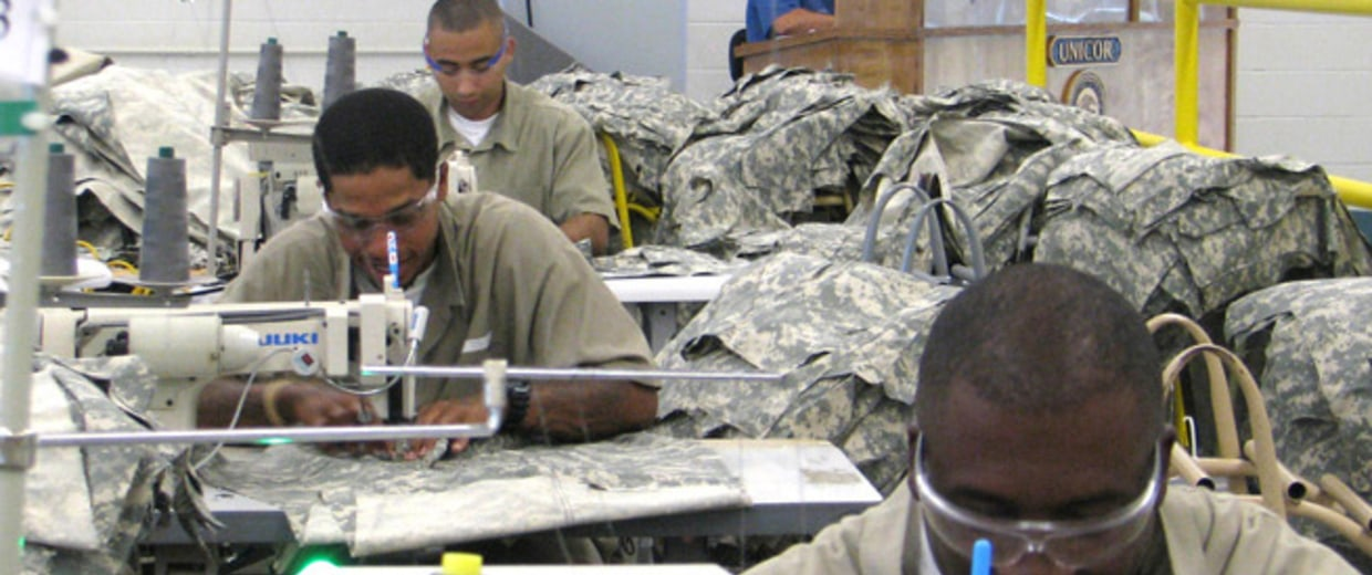 Image: Inmates work on garments at a Federal Prison Industries facility