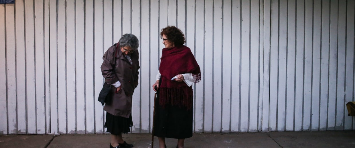 "In this Sept. 5, 2016 photo, Violeta Zuniga, 83, right, and Martha Perez, 80, members of the ""Cueca Sola"" dance group, talk before performing at a school in Santiago, Chile."