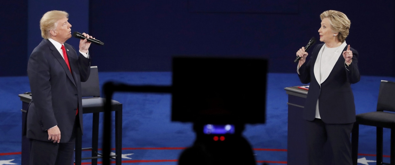 Image: Republican U.S. presidential nominee Donald Trump and Democratic U.S. presidential nominee Hillary Clinton speak during their presidential town hall debate at Washington University in St. Louis