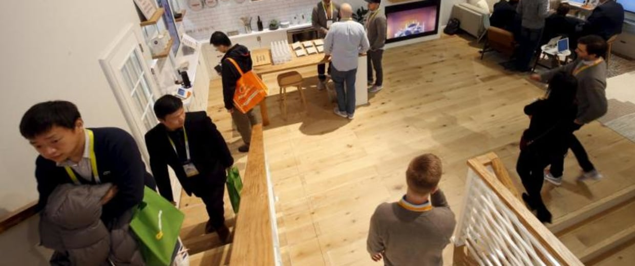 Attendees tour a Vivint Smart Home during the 2016 CES trade show in Las Vegas, Nevada