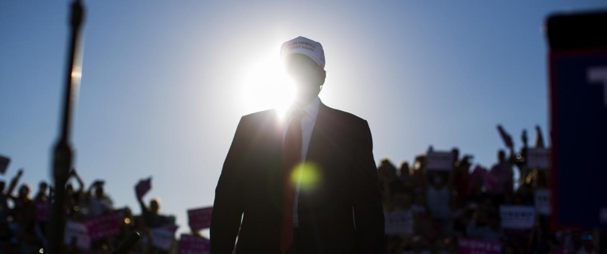 Image: Donald Trump arrives to speak to a campaign rally in Naples