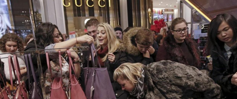 Women shop for handbags at Macy