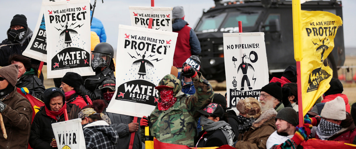 Image: Dakota Access Pipeline protesters square off against police