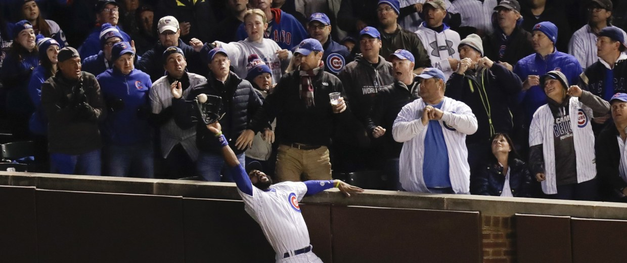 Image: Chicago Cubs right fielder Jason Heyward catches a fly ball hit by Cleveland Indians' Trevor Bauer during the third inning of Game 5 of the Major League Baseball World Series