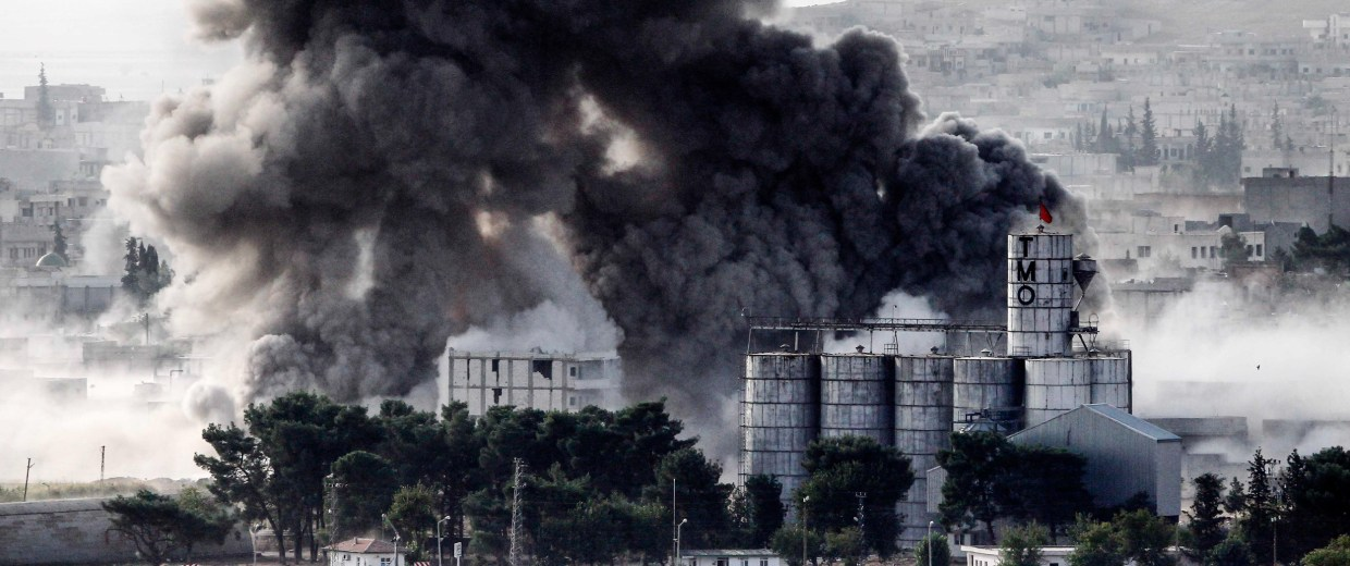 Image: Heavy smoke rises following an airstrike by aircraft from the U.S.-led coalition in Kobani, Syria