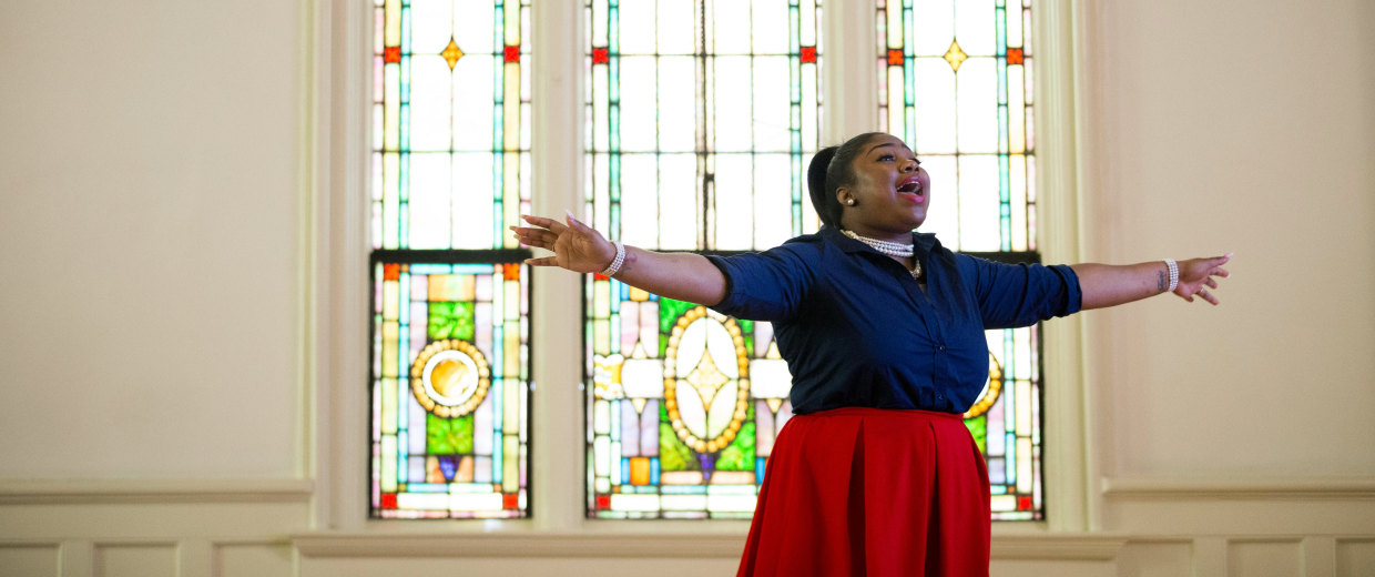Octavia Jones reacts as pastor Billy Honor preaches during a church service at Pulse Church