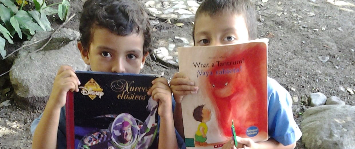 Students with new books in San Jacinto, El Salvador.