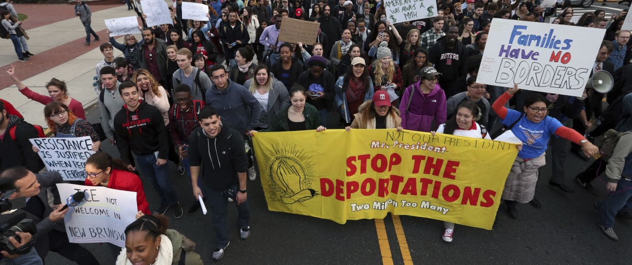 Hundreds of Rutgers University students block College Ave., in New Brunswick, N.J., as they march to protest some of President elect Donald Trump's policies and to ask school officials to denounce some of his plans at Rutgers University Wednesday, Nov. 16