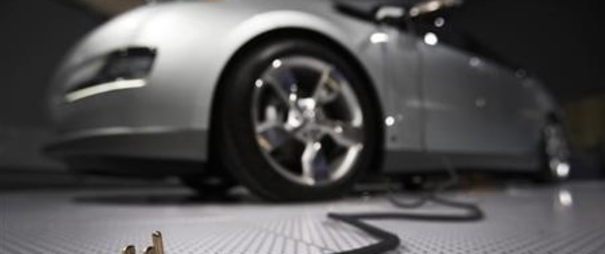 A plug is seen coming from the Chevrolet Volt electric car during the North American International Auto Show in Detroit