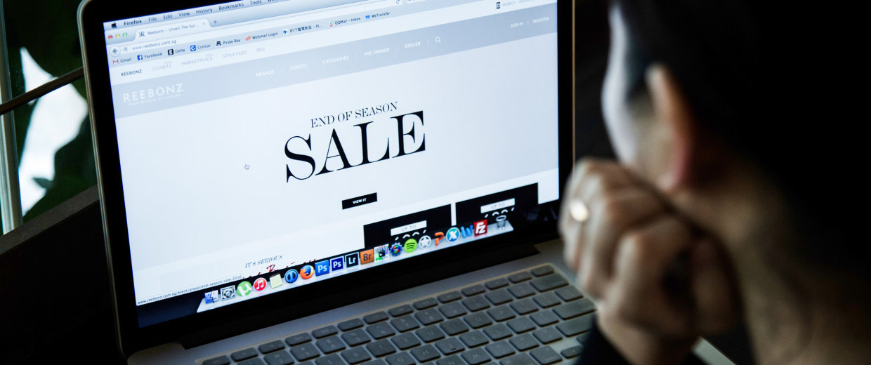 Image: A woman online shopping at online fashion retailer Reebonz