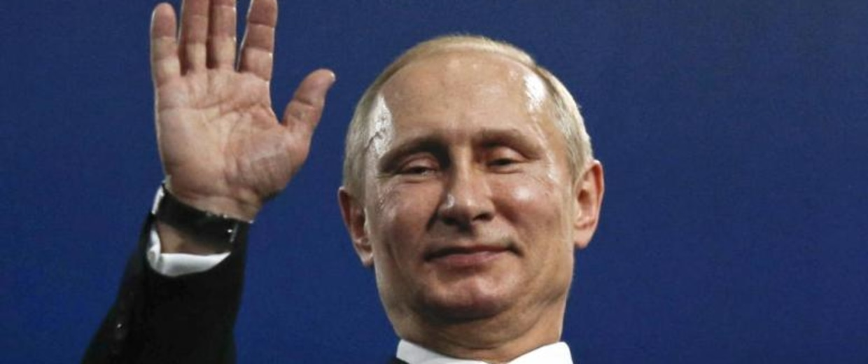 Russia's President Putin waves during the closing ceremony for the 2014 Sochi Winter Olympics