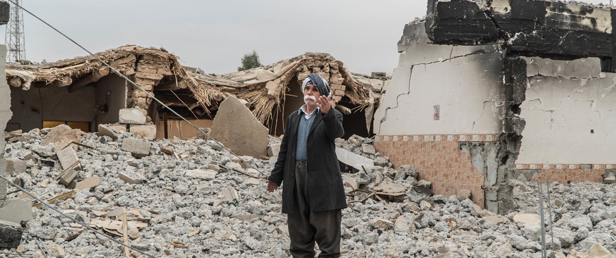 Image: Hamid Zorab, 73, stands on a pile of rubble that was once his living room.