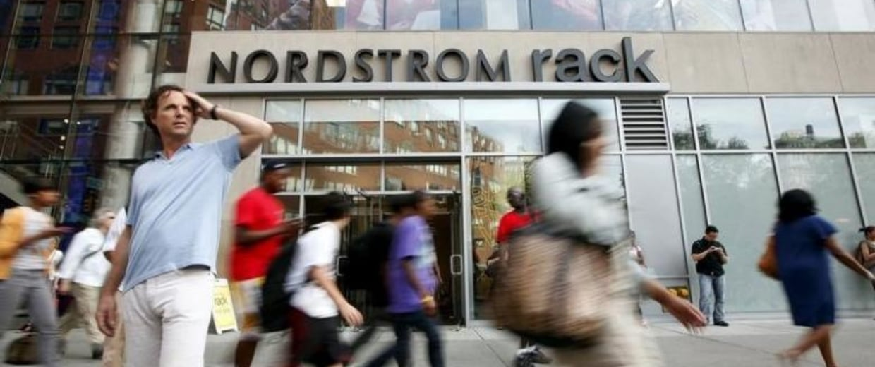 People walk past the Nordstrom Rack store, in New York's Union Square