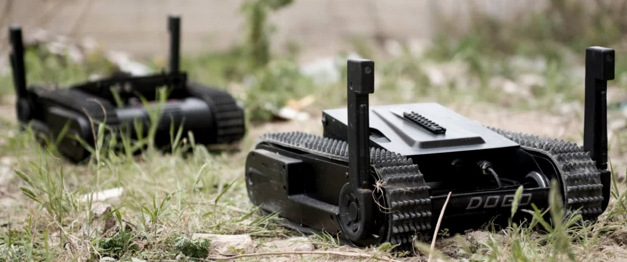 """Image: The DOGO Robot is a light robot, armed with a 9 mm Glock pistol. It is your robotic """"watch dog"""" at the field."""