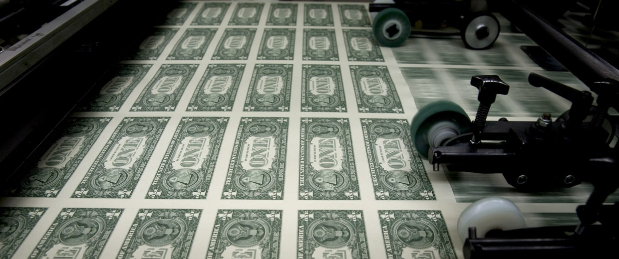 Image: One dollar note sheets are run through an intaglio printing press