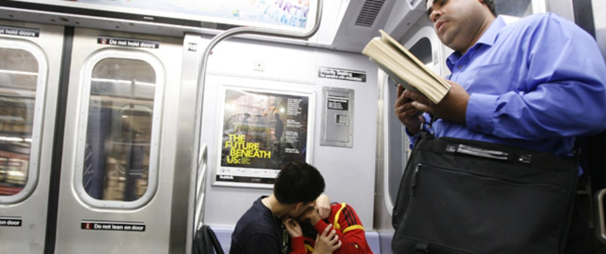 Couple kisses while riding the subway in New York