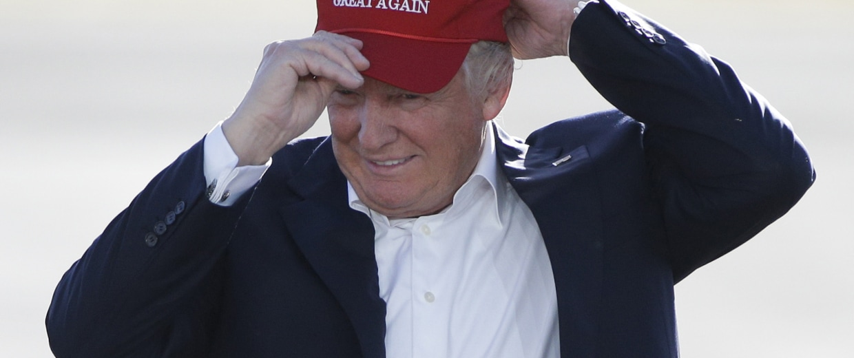 """Image: Republican presidential candidate Donald Trump wears his """"Make America Great Again"""" hat"""
