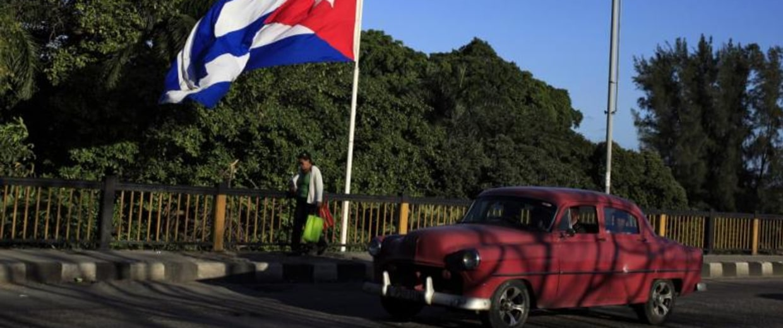 A Cuban flag flies over 'Almendares' bridge in Havana