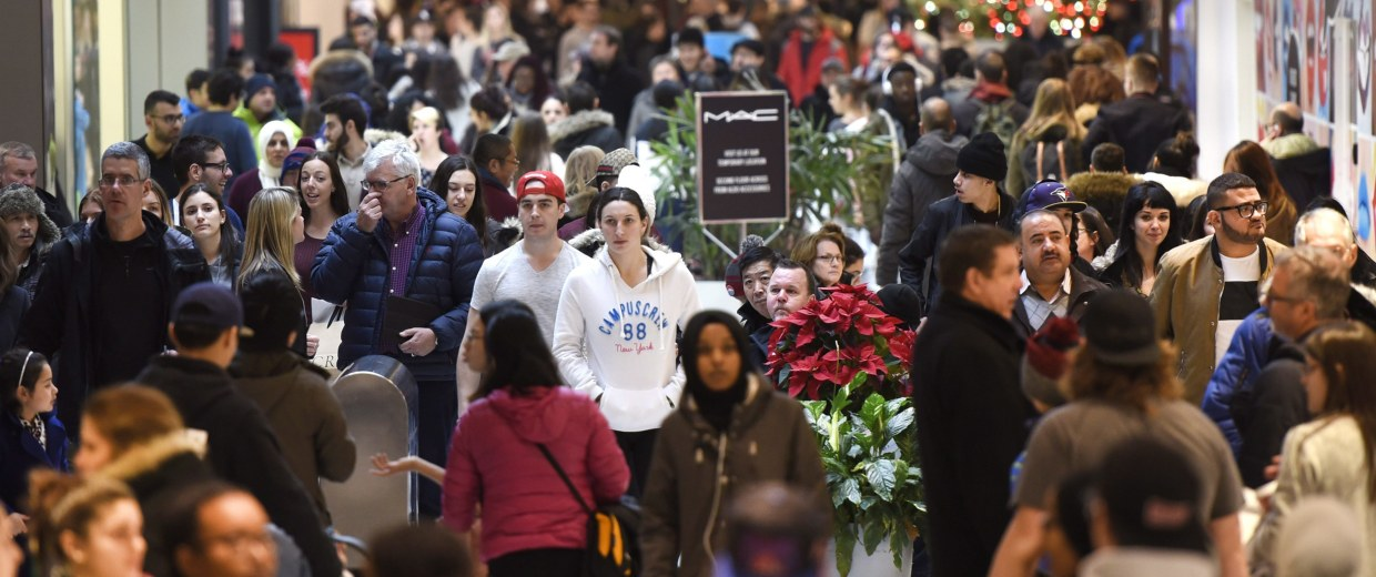 Image: Shoppers walk through the Rideau Centre