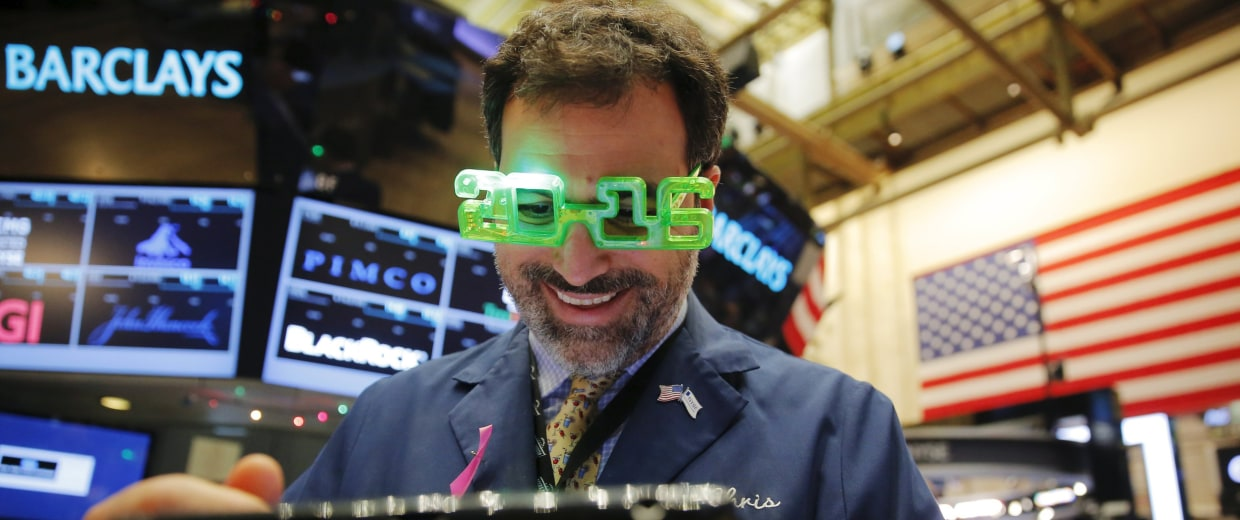 Image: A trader wears plastic glasses to celebrate the last trading day of 2015 as he works on the floor of the New York Stock Exchange shortly after the opening bell in New York