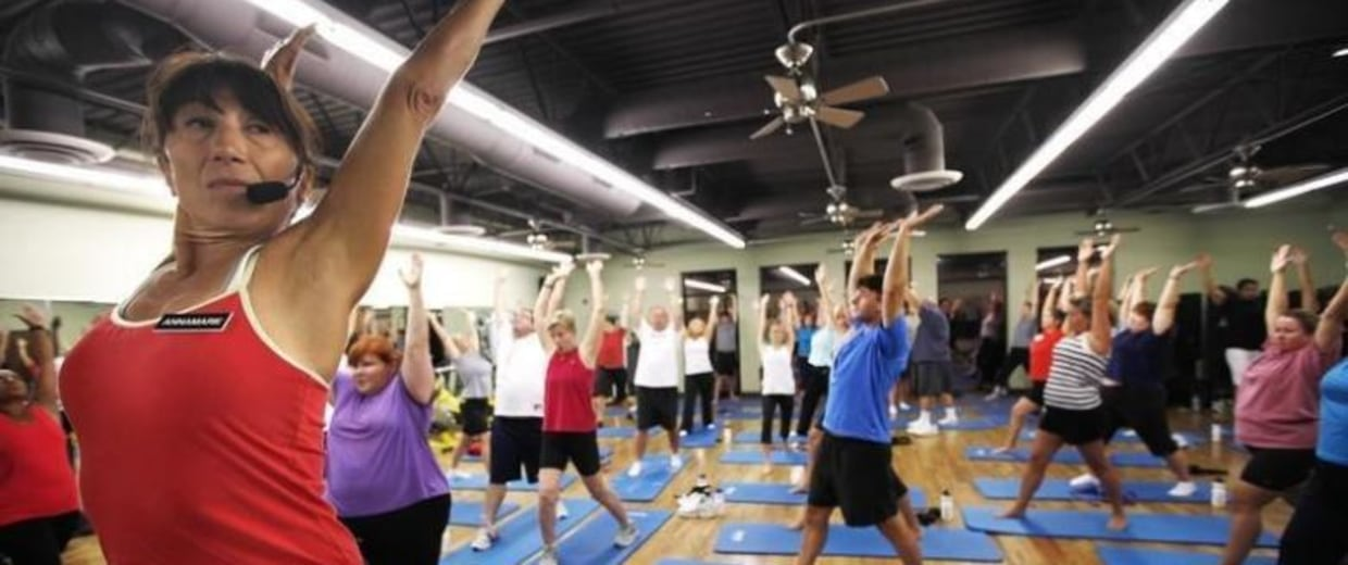 Trainer Anne Marie Smith leads guests in a Pilates workout before dawn at the Biggest Loser Resort in Ivins