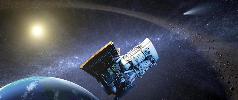 Wide-field Infrared Survey Explorer, or WISE spacecraft, in its orbit around Earth